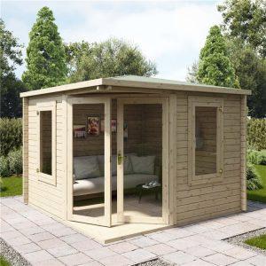 corner log cabin summerhouse in a british garden