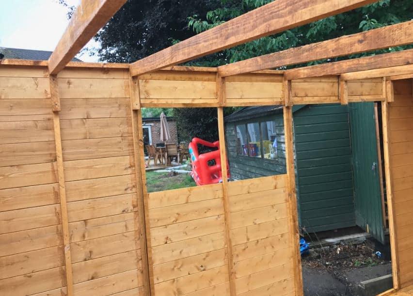 Workshop shed under construction in a garden
