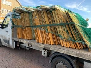 BillyOh flatpack shed panels on a delivery truck covered in netting