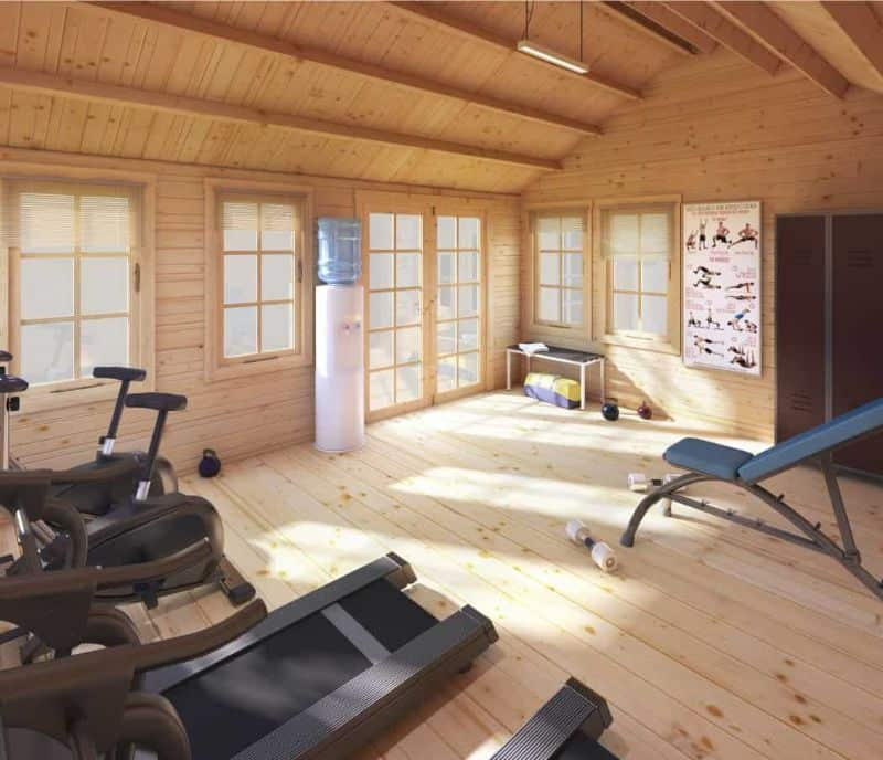 Set up durable flooring in your log cabin gym