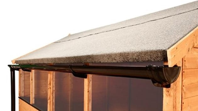 felt roof shed with black gutters