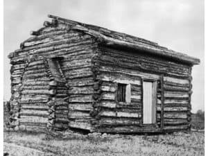 black and white photograph of a log cabin