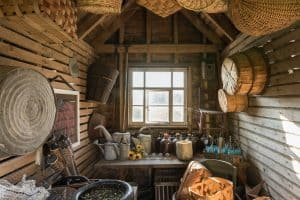 log cabin interior facing a window at the far end with sunlight coming to a room with woven baskets hanging from the walls and ceiling